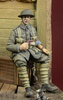 WWI British Infantryman sitting on a case - Image 1